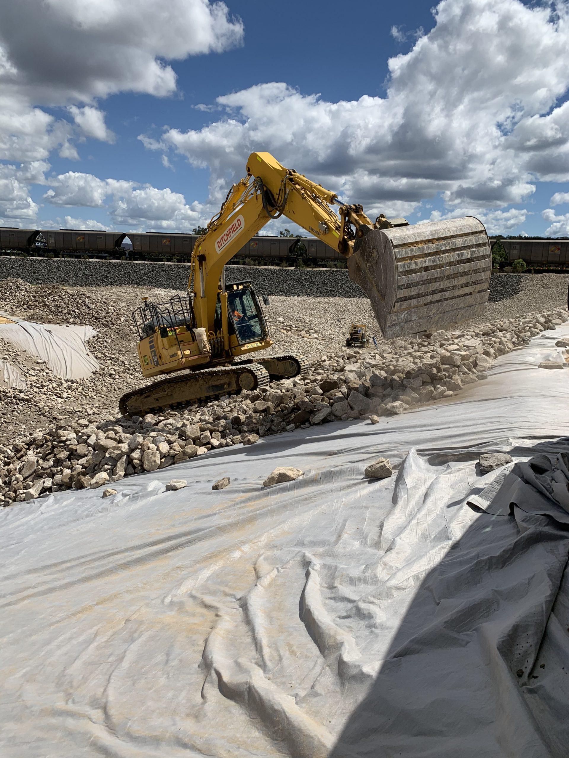 Mining Services - Moolarben WTF Digger placing rock lining